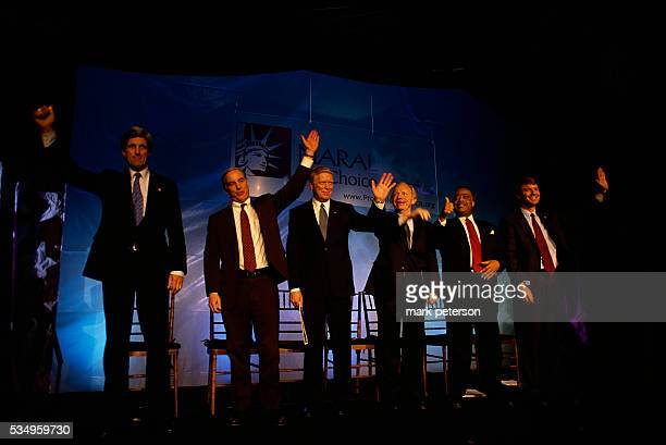 Democratic Presidential candidates waving on a stage at the NARAL prochoice dinner in Washington DC in January 2003 From left to right Senator John...