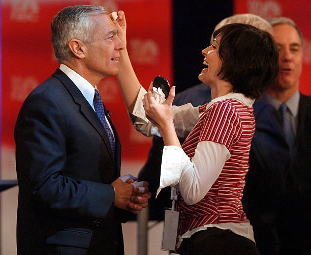 Democratic presidential candidates Wesley Clark has makeup applied during a break at a debate January 29
