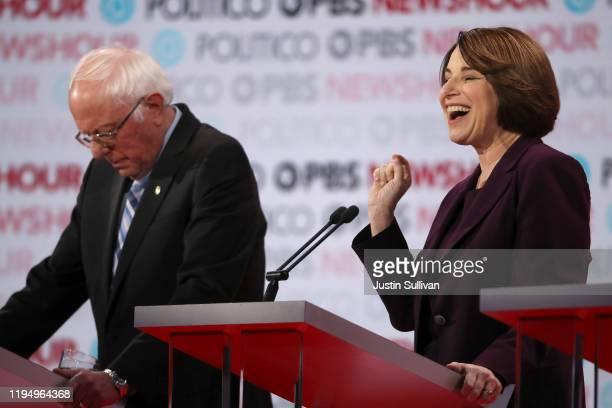 Democratic presidential candidatte Sen Amy Klobuchar speaks as Sen Bernie Sanders listens during the Democratic presidential primary debate at Loyola...
