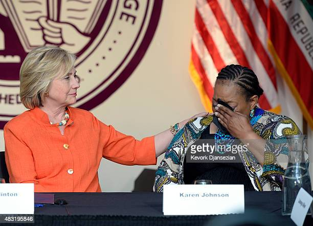 Democratic Presidential hopeful and former Secretary of State Hillary Clinton comforts Karen Johnson a home care consumer from Los Angeles during a...