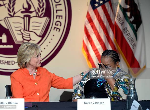 Democratic Presidential hopeful and former Secretary of State Hillary Clinton comforts Karen Johnson a home care recipient from Los Angeles during a...