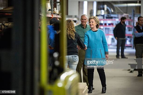 Democratic presidential hopeful and former US Sectetary of State Hillary Clinton ahakes hands as she arrives to speak to employees of Whitney...