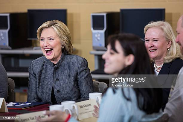 Democratic presidential hopeful and former U.S. Sectetary of State Hillary Clinton laughs while speaking with students and faculty of New Hampshire...