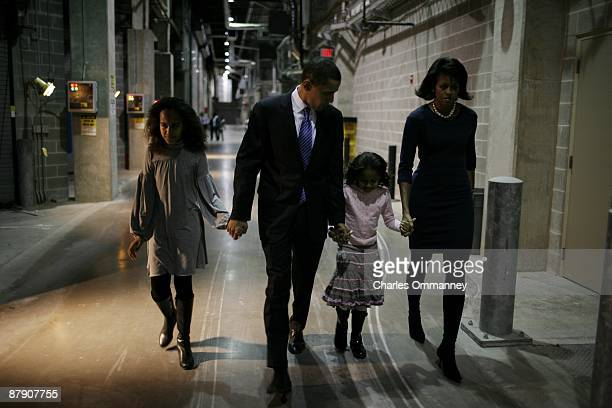 EXCLUSIVE Democratic presidential hopeful and Illinois Senator Barack Obama backstage with his wife Michelle and daughters Sasha and Malia at HyVee...