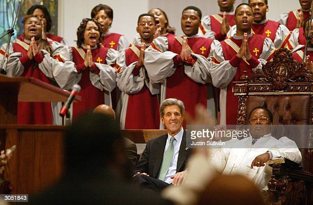 Democratic presidential hopeful and US Senator John Kerry attends church services with Bishop Phillip Coleman Sr at the Greater Bethlehem Temple...