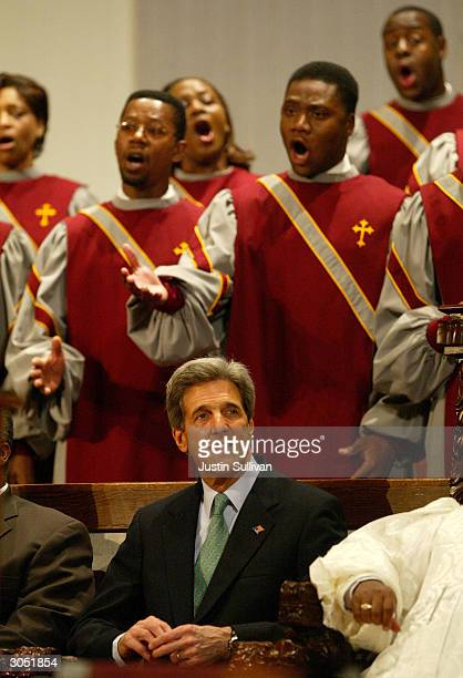 Democratic presidential hopeful and US Senator John Kerry sits as he attends church services at the Greater Bethlehem Temple Apostolic Faith Church...