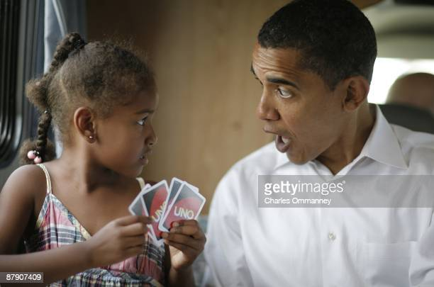 Democratic presidential hopeful Barack Obama his wife Michelle and two daughters Sasha and Malia play cards in their RV July 4 2007 on a campaign...