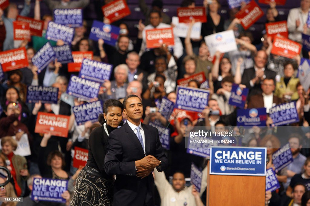 Democratic presidential hopeful Barack Obama is embraced by his wife Michelle as he addresses supporters at a primary election results rally in Nashua, 08 January 2008. According to US media reports, Obama lost the state to rival New York Senator Hillary Clinton. AFP PHOTO/Emmanuel DUNAND