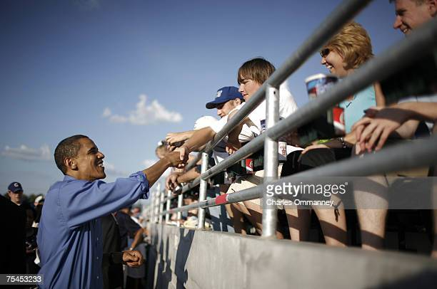 Democratic presidential hopeful Barack Obama is joined by his wife Michelle and daughters Malia and Sasha at a Iowa Cubs minor league baseball game...