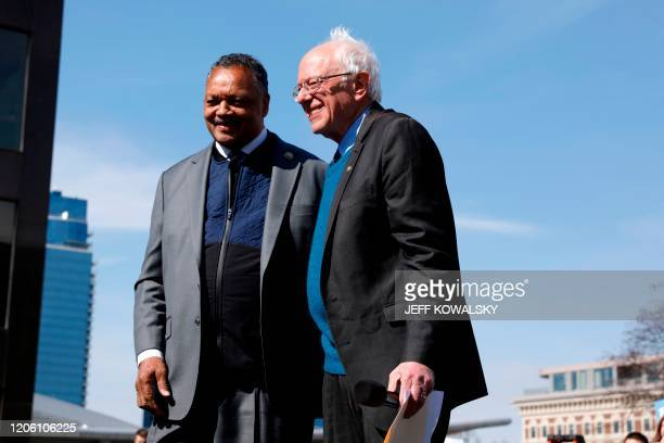 Democratic presidential hopeful Bernie Sanders With Rev Jesse Jackson while addressing supporters during a campaign rally in downtown Grand Rapids...