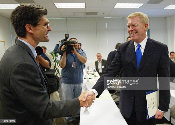 Democratic presidential hopeful Dick Gephardt shakes hands with Carl Guardino President and CEO of the Silicon Valley Manufacturing Group June 17...