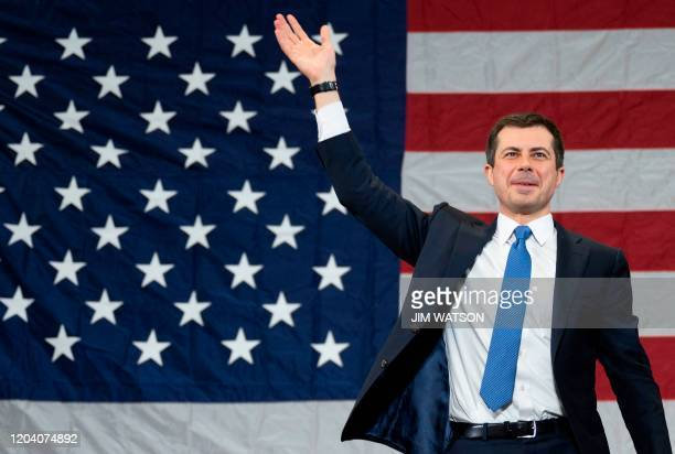Democratic presidential hopeful former Mayor of South Bend, Indiana, Pete Buttigieg waves as he arrives to speak during a rally in Columbia, South...