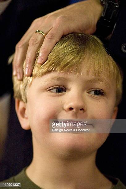 Democratic presidential hopeful former Senator John Edwards introduces his son Jack during a campaign stop at the VFW Hall in Algona Iowa Monday...