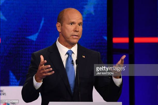 Democratic presidential hopeful former US Representative for Maryland's 6th congressional district John Delaney gestures as he speaks during the...