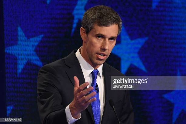Democratic presidential hopeful former US Representative for Texas' 16th congressional district Beto O'Rourke gestures as he speaks during the first...