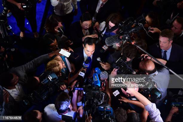 Democratic presidential hopeful Former US Secretary of Housing and Urban Development Julian Castro speaks with the press at the Spin Room after the...