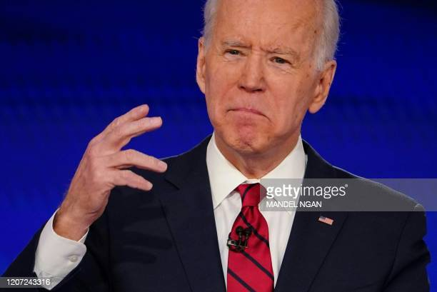 Democratic presidential hopeful former US vice president Joe Biden makes a point as he and Senator Bernie Sanders take part in the 11th Democratic...