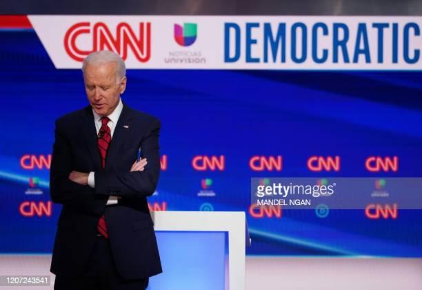 Democratic presidential hopeful former US vice president Joe Biden is seen on stage as he and Senator Bernie Sanders take part in the 11th Democratic...