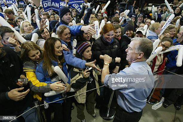 Democratic presidential hopeful former Vermont Gov. Howard Dean shakes hands with supporters gathered at Pease International Airport January 20, 2004...
