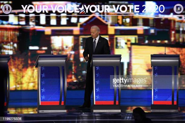 Democratic presidential hopeful former Vice President Joe Biden stands onstage during a break in the eighth Democratic primary debate of the 2020...