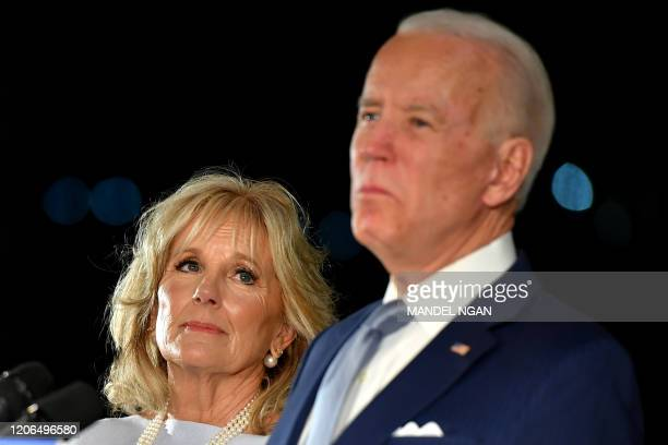 Democratic presidential hopeful former Vice President Joe Biden speaks, flanked by his wife Jill Biden, at the National Constitution Center in...