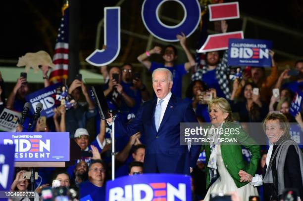 Democratic presidential hopeful former Vice President Joe Biden arrives onstage with his wife Jill and sister Valerie for a Super Tuesday event in...