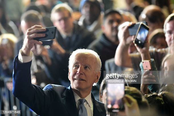 TOPSHOT Democratic presidential hopeful former Vice President Joe Biden takes a selfie with supporters after addressing a Super Tuesday event in Los...
