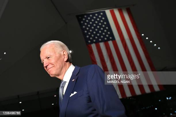 TOPSHOT Democratic presidential hopeful former Vice President Joe Biden walks out after speaking at the National Constitution Center in Philadelphia...