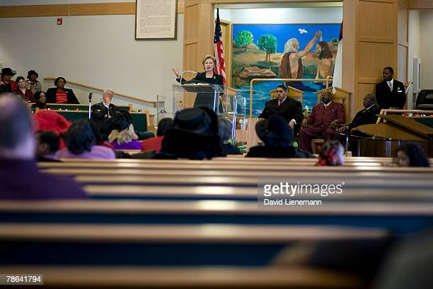 Democratic presidential hopeful Hillary Clinton speaks while her husband former president Bill Clinton watches during services at Mt Carmel Baptist...