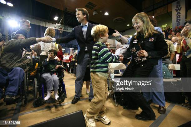 Democratic Presidential hopeful John Edwards and his son Jack are greeted by supporters as they arrive for a town hall gathering at Theodore...