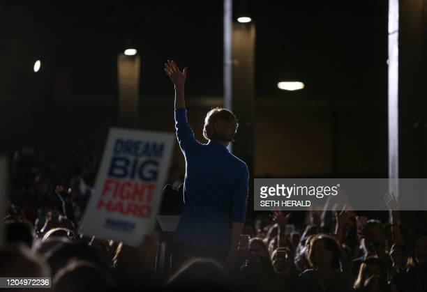 Democratic Presidential hopeful Massachusetts Senator Elizabeth Warren waves during a rally March 3 2020 in Detroit Michigan at the Detroit Kitchen...
