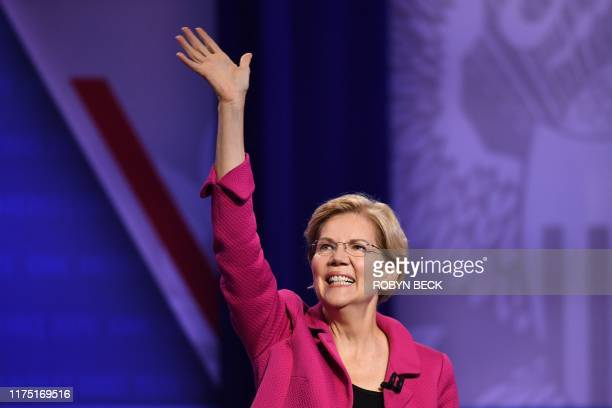 Democratic presidential hopeful Massachusetts Senator Elizabeth Warren waves as she arrives for a town hall devoted to LGBTQ issues hosted by CNN and...