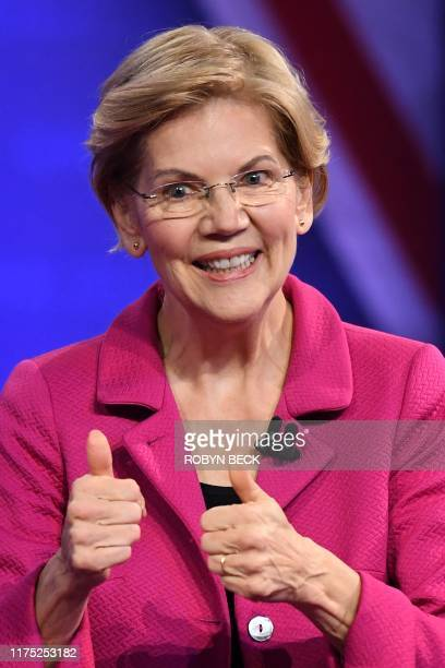 Democratic presidential hopeful Massachusetts Senator Elizabeth Warren gestures as she speaks during a town hall devoted to LGBTQ issues hosted by...