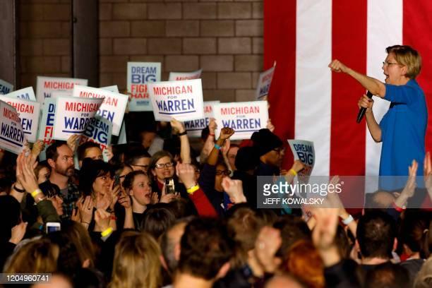 Democratic presidential hopeful Massachusetts Senator Elizabeth Warren gestures as she speaks during a campaign rally at Eastern Market in Detroit...