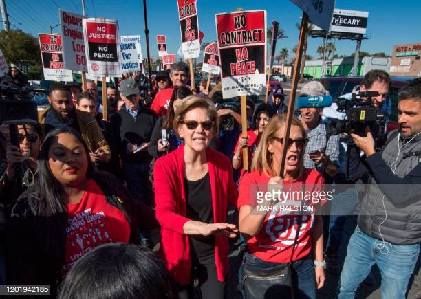 Democratic presidential hopeful Massachusetts Senator Elizabeth Warren joins members of the Culinary Workers Union Local 226 who are picketing...