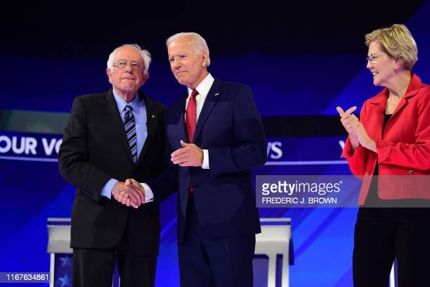 Democratic presidential hopeful Massachusetts Senator Elizabeth Warren looks on as former Vice President Joe Biden and Vermont Senator Bernie Sanders...