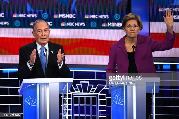 Democratic presidential hopeful Massachusetts Senator Elizabeth Warren gestures next to former New York Mayor Mike Bloomberg during the ninth...