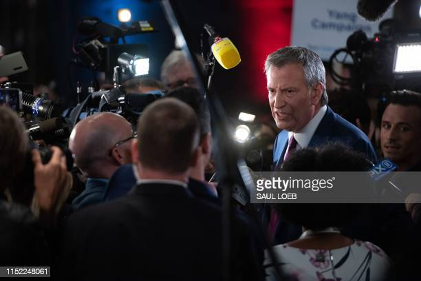 Democratic presidential hopeful Mayor of New York City Bill de Blasio speaks to the press in the spin room after participating in the first...