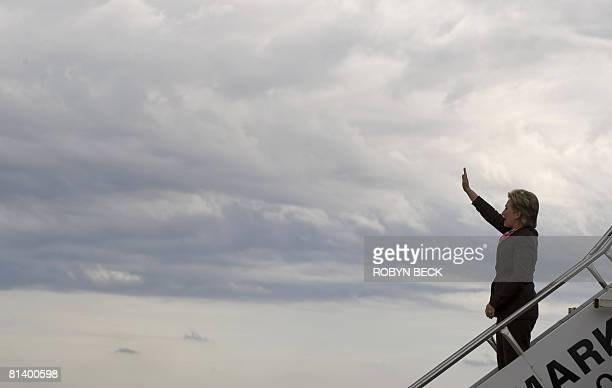 Democratic presidential hopeful New York Senator Hillary Clinton speaks at a campaign event at WH Lyon Fairgrounds waves as she exits her charter...