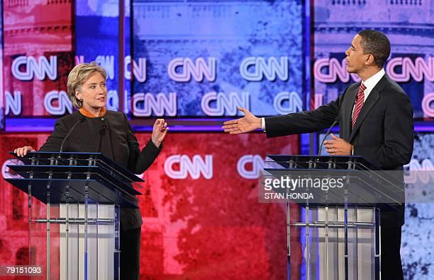 Democratic presidential hopeful New York Senator Hillary Rodham Clinton and Illinois Senator Barack Obama exchange comments during the Democratic...