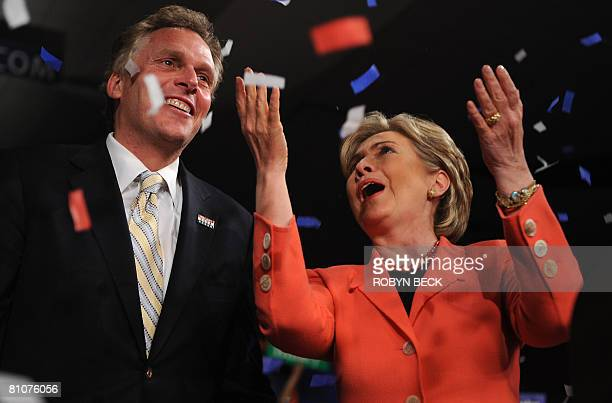 Democratic presidential hopeful New York Senator Hillary Rodham Clinton and campaign chairman Terry McAuliffe celebrate at her primary election night...