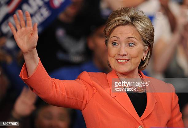 Democratic presidential hopeful New York Senator Hillary Rodham Clinton waves as she takes the stage at her primary election night celebration at the...