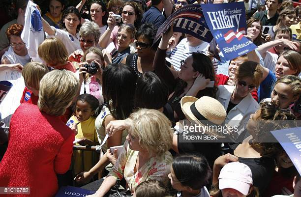 Democratic presidential hopeful New York Senator Hillary Rodham Clinton signs autographs at a campaign event outside McMurran Hall at Shepherd...