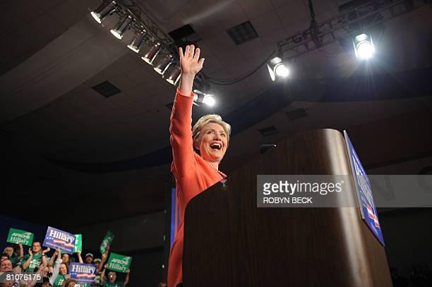 Democratic presidential hopeful New York Senator Hillary Rodham Clinton waves at her primary election night celebration at the Charleston Civic...
