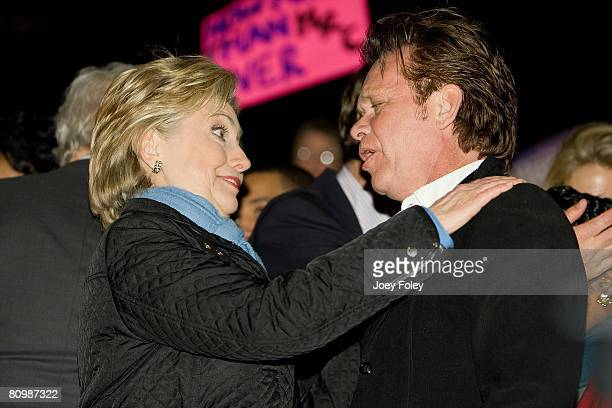 Democratic presidential hopeful New York Senator Hillary Rodham Clinton talks with singer John Mellencamp after her speech at a campaign stop at...