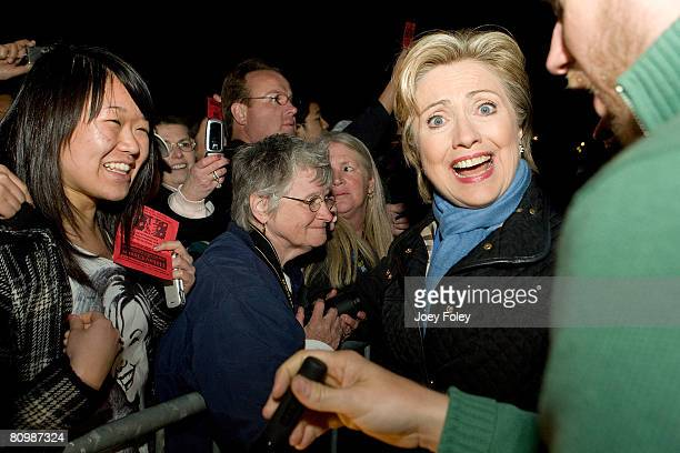 Democratic presidential hopeful New York Senator Hillary Rodham Clinton reaction to seeing a supporter's t-shirt in the crowd following her speech at...