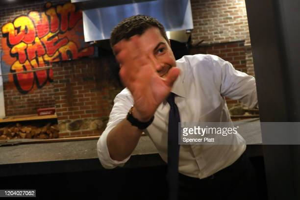 Democratic presidential hopeful Pete Buttigieg greets supporters at a pizzeria in Hampton New Hampshire the morning after the flawed Iowa caucus on...