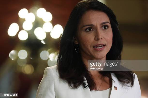 Democratic Presidential hopeful Rep Tulsi Gabbard participates in a TV interview at the US Capitol January 9 2020 in Washington DC The House has...