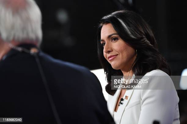 Democratic presidential hopeful Representative for Hawaii Tulsi Gabbard speaks to the press in the Spin Room following the fifth Democratic primary...