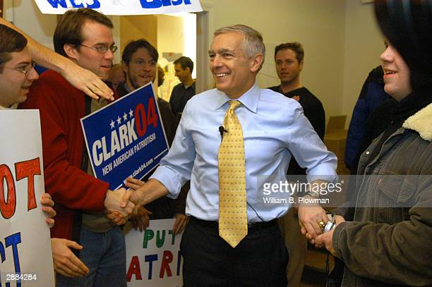 Democratic presidential hopeful Ret Gen Wesley Clark greets his campaign staff and volunteers at Clark headquarters January 20 2004 in Manchester New...